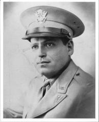 Photograph of Captain Nathan Silver, M.D., in Military uniform at 34th Evacuation Hospital