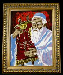 Portrait of a Rabbi Holding a Torah, done in needle point