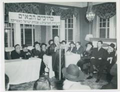 Rabbi Eliezer Silver speaking at an Agudath Israel Convention, also seen in the picture are Rabbi Aharon Kotler and Rabbi Moshe Feinstein