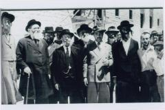 Rabbi Elizer Silver Outdoors in Israel Surrounded by a Group of Unidentified Men