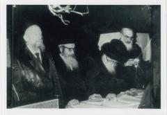 Rabbi Eliezer Silver Standing and Davening with a Group of Unidentified Rabbanim
